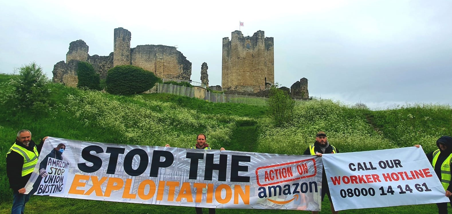 Amazon Workers holding protest banners